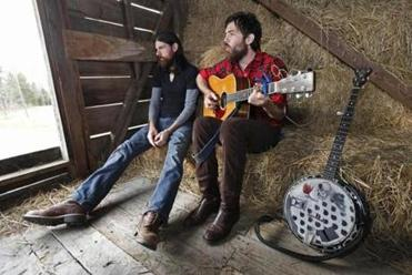 From left: Seth and Scott Avett — along with bassist Bob Crawford — are the heart of the Avett Brothers.